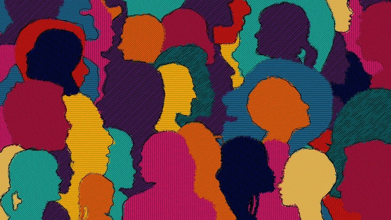 colorful drawing of multiple head silhouettes